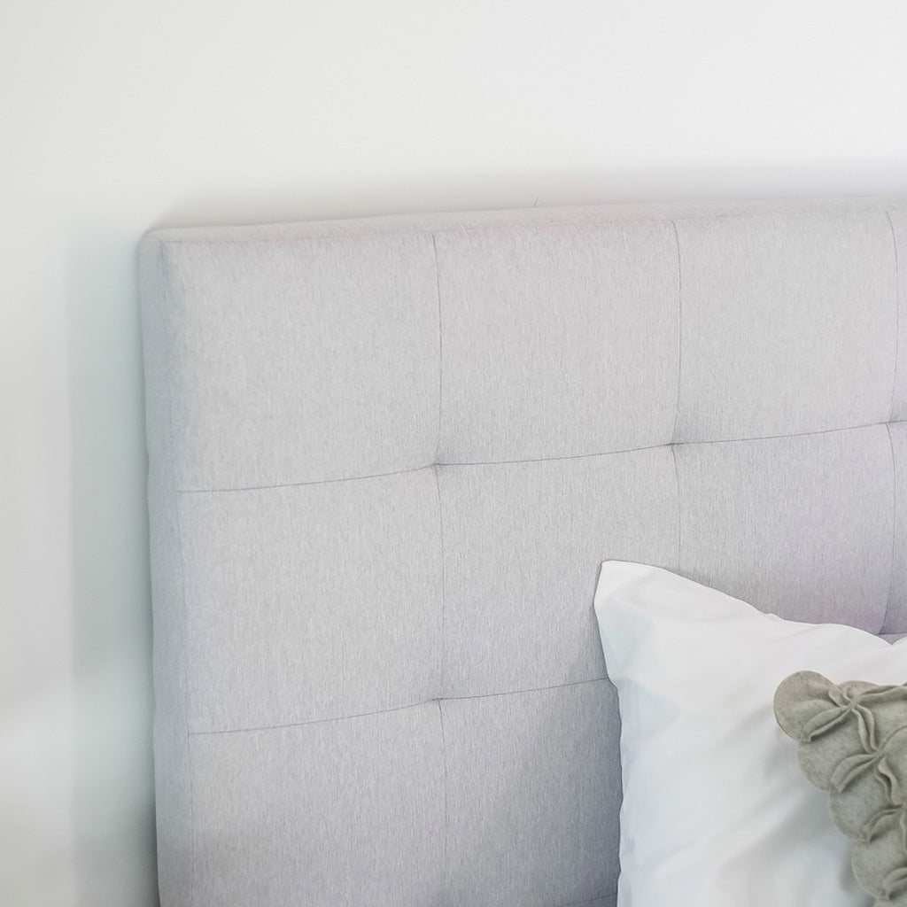 Product image of the June Storage Bed. Shown in horizon grey. Close up of headboard detail and fabric.