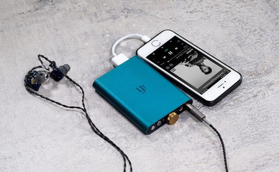 ifi hip dac shown with phone & earphones, not included