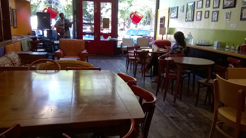 Nice Coffee Shop Interior with  guitar singer
