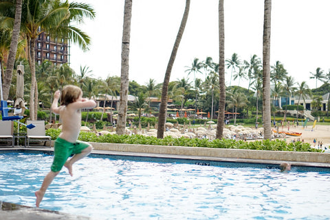 Miles leaping into the Four Seasons Oahu Pool