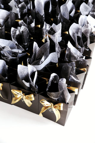 Luxury matte black conference bags with branded ribbon and marble tissue paper Sydney