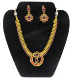 Elegant red and green kundan polki set with stud earrings