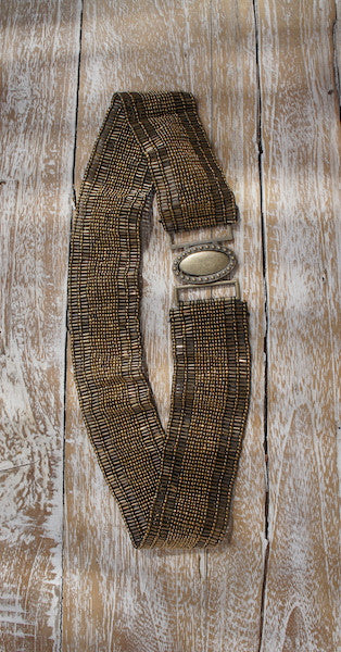 This elegant waist belt is a beautiful addition to any wardrobe.Its made entirely out of small tubelar and spherical beads and stretches along the entire length...