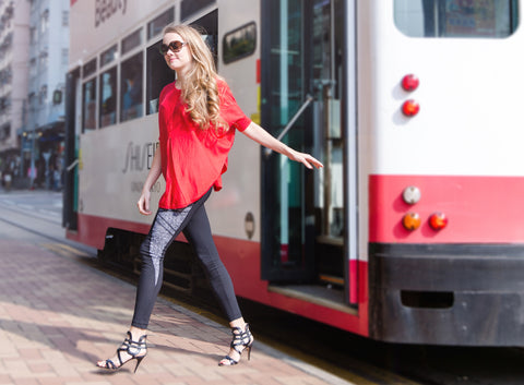 Model in Zarie Dream leggings getting off tram
