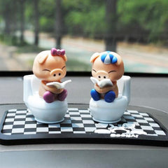 Q Version Toilet Reading Lover Pig Solar Shook his Head Doll Car Ornaments