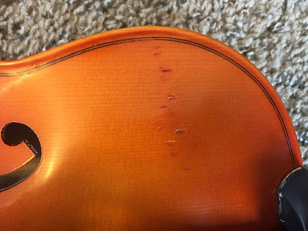 Little dents on this portion of the violin