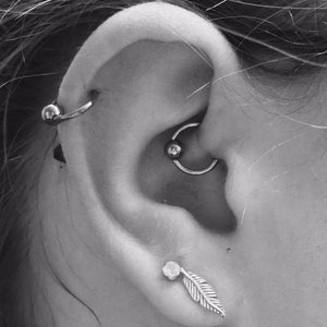 Helix and daith piercing by Emma at Isha Body Jewellery