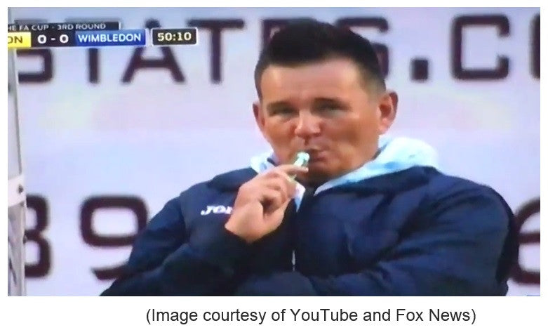 Social media goes bonkers when Sutton manager is caught vaping during FA Cup contest