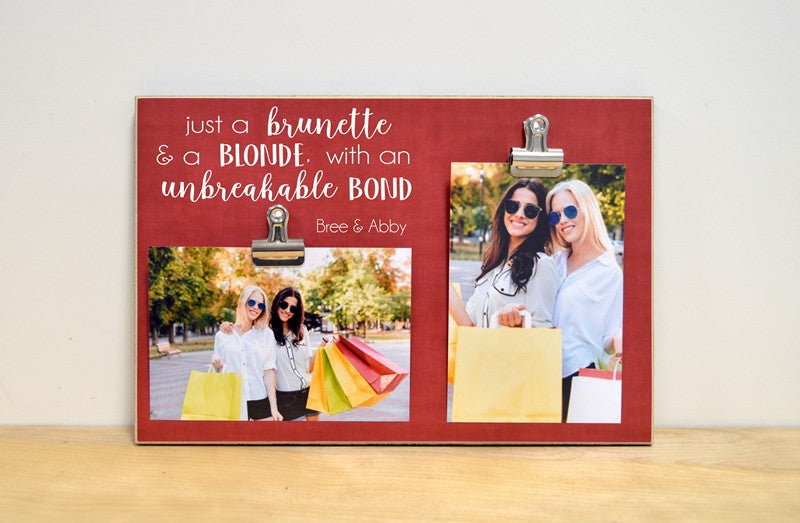 2 clip photo frame reading a brunette and a blonde with an unbreakable bond holds 2 4x6 photos, a fun best friends gift