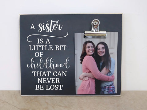 sisters photo frame, a sister is a little bit of childhood that can never be lost