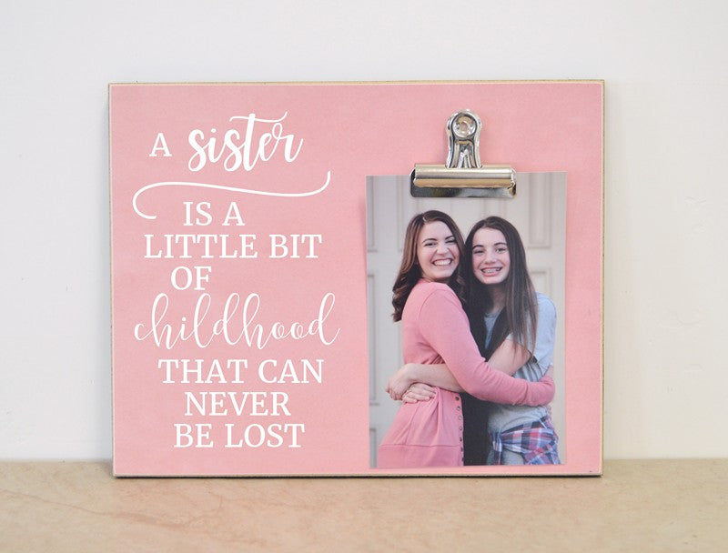 a sister is a little bit of childhood that can never be lost photo frame