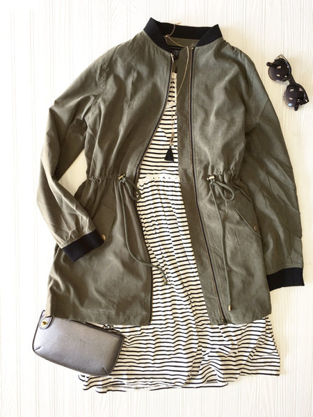 bomber jacket paired with black & white stripe dress