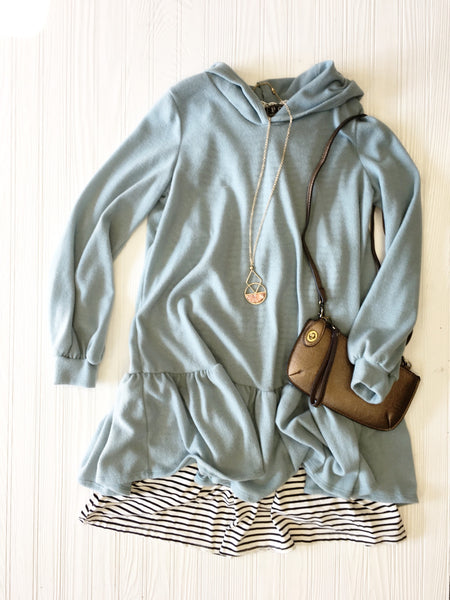 Ruffle hem hooded sweatshirt over black & white stripe dress