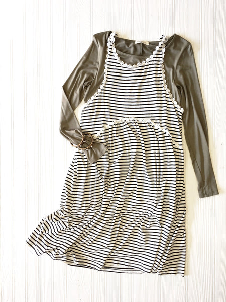 olive green long sleeve under a black & white stripe dress