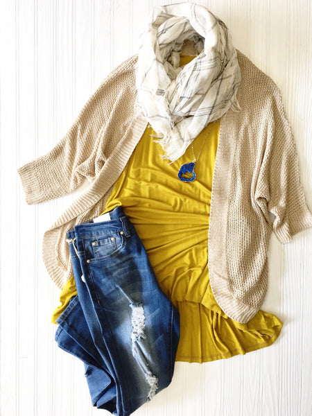 gold dress worn with distressed jeans and cream cardigan
