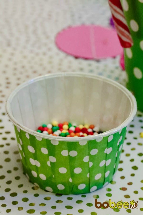 green treat cups with sprinkels