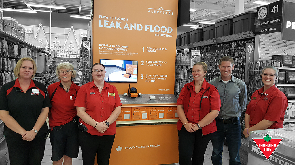 Alert Labs' project manager Charlie Harland with staff at Canadian Tire Sunrise Centre in Kitchener