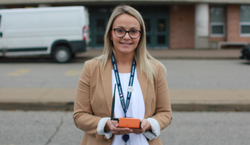 Jessica Kukac of Simcoe County School Board holding Flowie water flow sensor