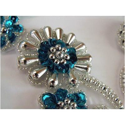 P-036 Turquoise and silver flower spray pair.