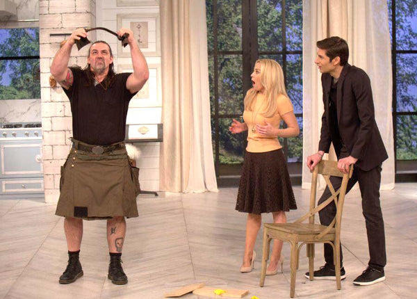 Iron Tamer Dave Whitley bends a pry bar for local TV morning show while wearing a utility kilt