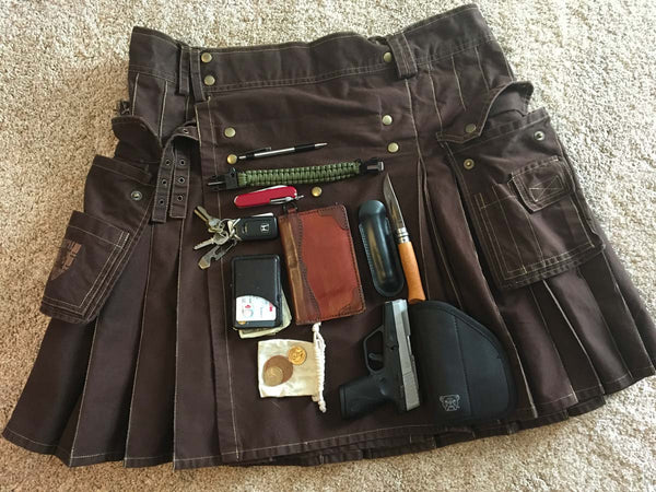 Pocket contents from a utility kilt include knives, tools, wallet, keys, and a pea shooter.