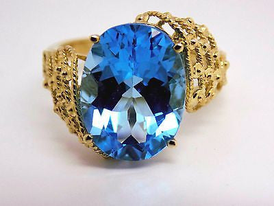 11 Ct. Swiss Blue Topaz Solitaire Ring 10k Fancy setting design Huge NEW 341