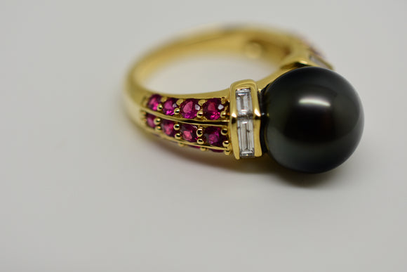 11mm Black Tahitian Pearl, .63 Ct Natural Ruby (2.5mm - 1.75mm) and .56 Ct Channel Set Baguette Cut Diamond Ring set in 14k Solid gold