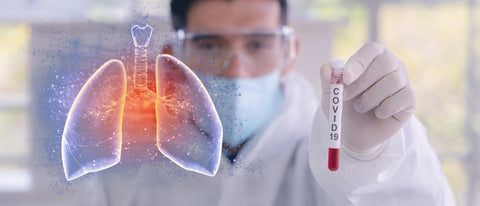 double exposure of coronavirus covid-19 infected blood sample in sample tube in hand of scientist with biohazard protection cloth and pneumonia lung