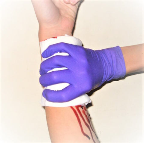 Applying pressure to stop bleeding. First aid for cuts and scrapes