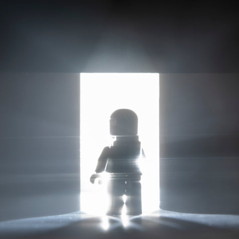 ...into the light. Lego photography by Tom Milton