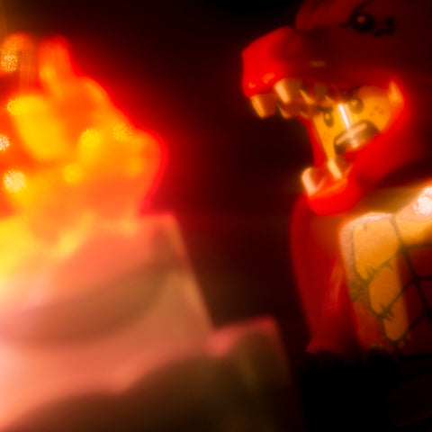 What does a dragon suit guy have to do to make a birthday wish? Lego photography by Tom Milton