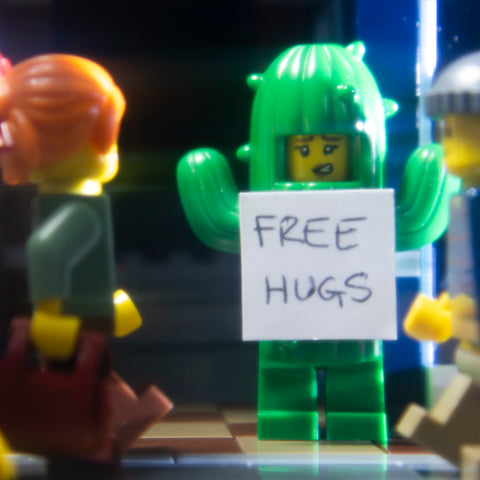 Free hugs. Lego photography by Tom Milton