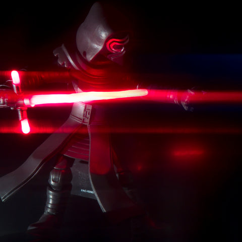 Darkness rises, and light to meet it. Toy photography by Tom Milton