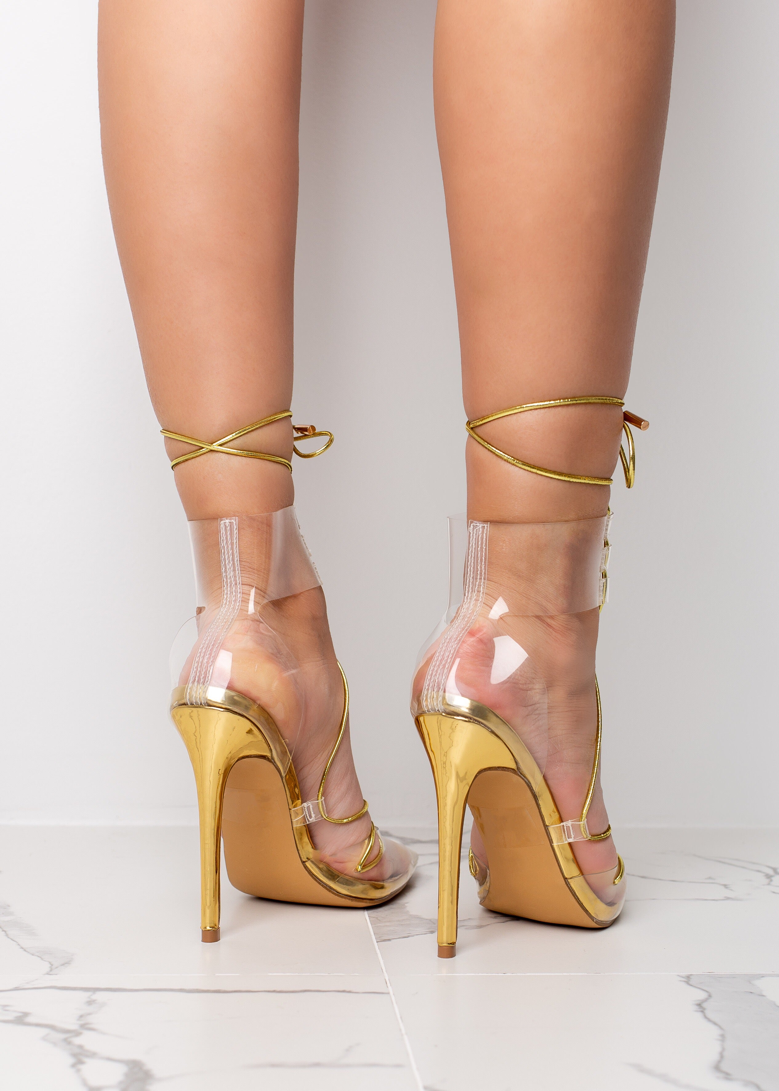 Clear Pointed Gold High Heel