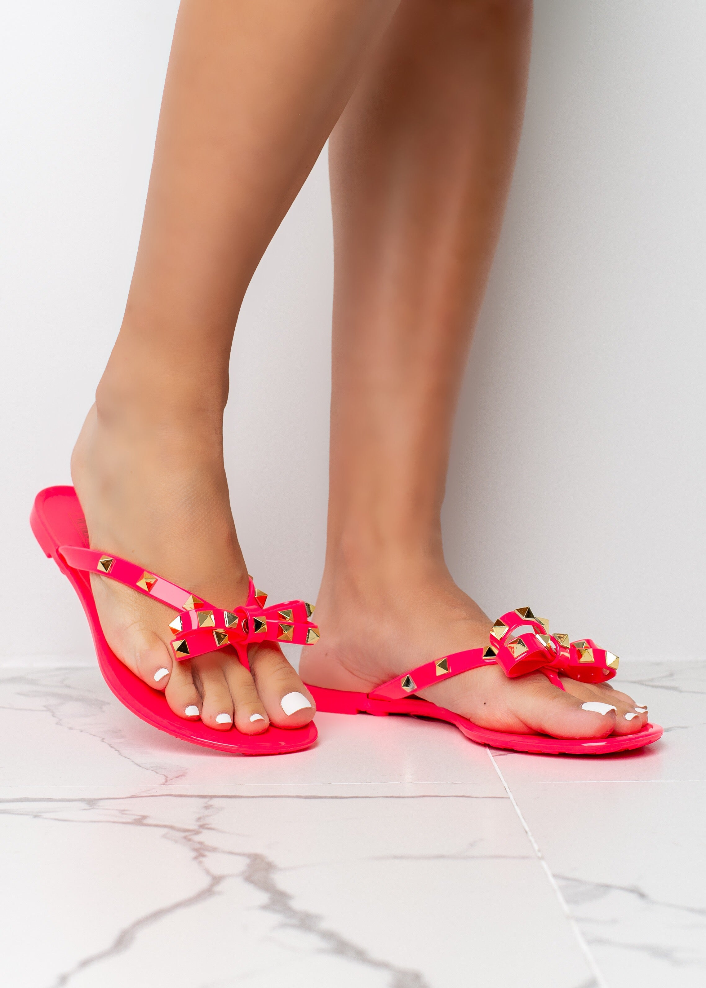 Tie The Knot Neon Fuchsia Jelly Stud Sandals