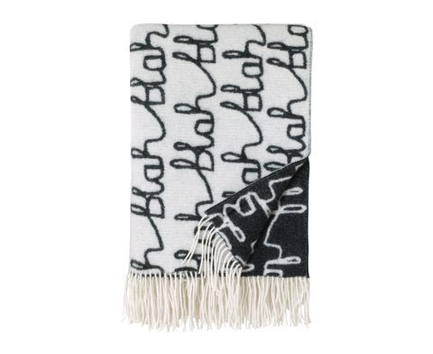 Blah Blah Lambs Wool Throw by Donna Wilson