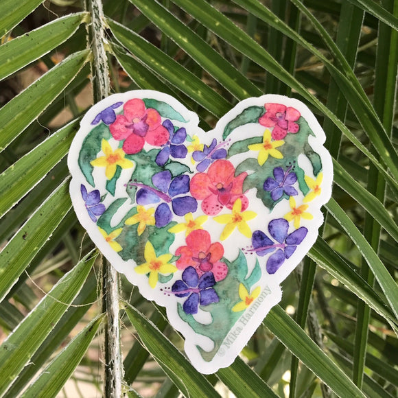 Botanical Tropical Flower Heart Sticker with CLEAR Background, featuring green monstera leaves, peach orchids, purple hibiscus and yellow Hawaiian plumeria. - Mika Harmony