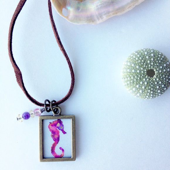 Pink Galaxy Seahorse with beaded charm Beachy jewelry on a brown sueded cord