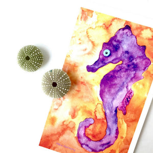 Lilikoi Sunrise Seahorse Watercolor artwork in saturated purple and tangerine colors