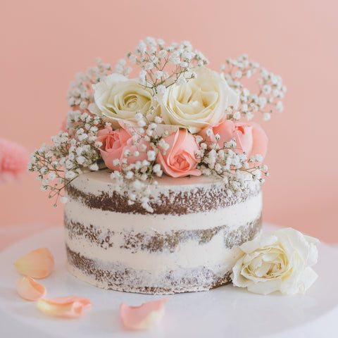 Naked cake with fresh flowers