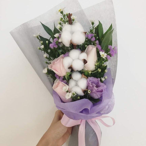 Bouquet of artificial cotton flowers, fresh pink roses, and lilac statice - M Cake Boutique