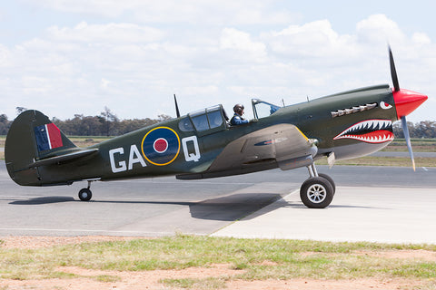 Image of a P-40N Kittyhawk while it taxis at Temora Airport.
