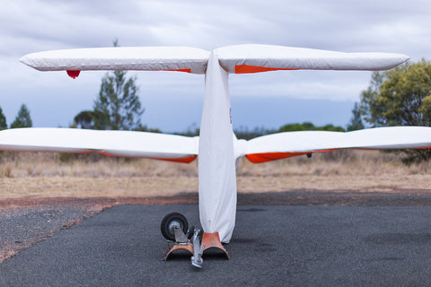 Image of a wrapped sailplane at West Wyalong Airport.