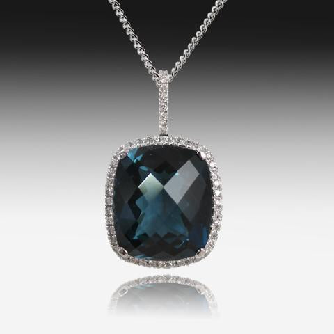 18kt White Gold Blue Topaz and Diamond pendant