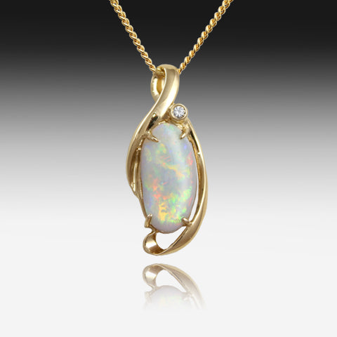 14kt Yellow Gold Crystal Opal and Diamond pendant