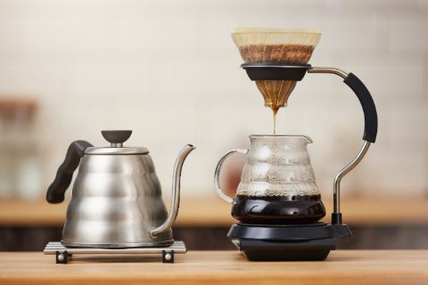 Close up of coffee brewing gadgets on wooden bar counter