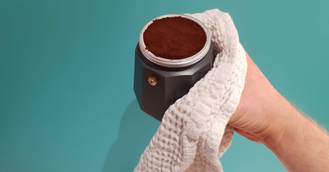 Fill the basket with freshly ground, level, uncompressed coffee