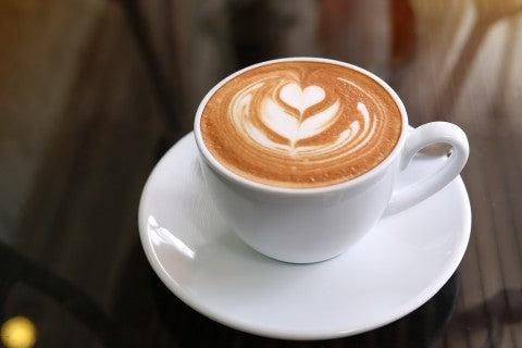 classic latte with a heart shaped milk froth