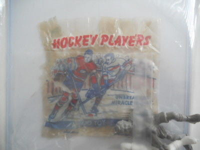 Hockey toys plus NHL wrapper 1950's