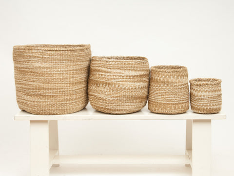 set of handwoven neutral African basket bin container